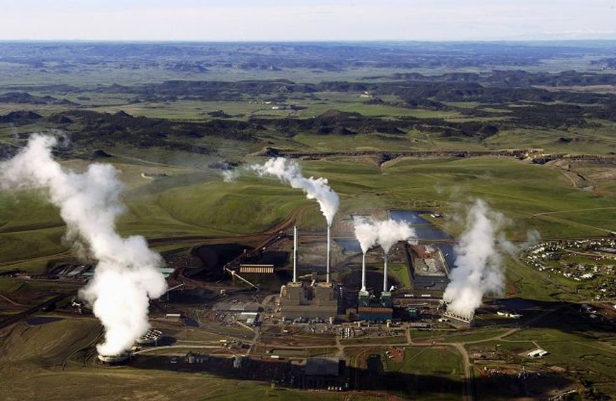 ** FILE ** This file photo from October 2008 shows a coal-fired power plant in Colstrip, Mont., the state's largest producer of the greenhouse gas carbon dioxide. (Associated Press)