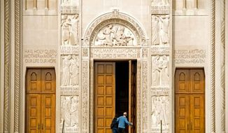 ** FILE ** People enter the Basilica of the National Shrine of the Immaculate Conception on the campus of Catholic University in Washington. (The Washington Times)