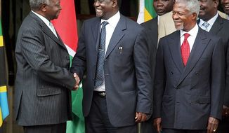 After Kenyan President Mwai Kibaki (left) reached a deal with opposition leader Raila Odinga on Thursday with the assistance of mediator Kofi Annan (right), the two sides prepared to reconvene to work out the implementation of a power-sharing government.