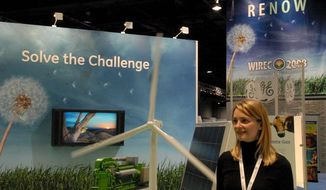 Christa Bowers, of Greenhouse Gas Services, explained wind power yesterday at the Washington International Renewable Energy Conference. (Tom Ramstack/The Washington Times)