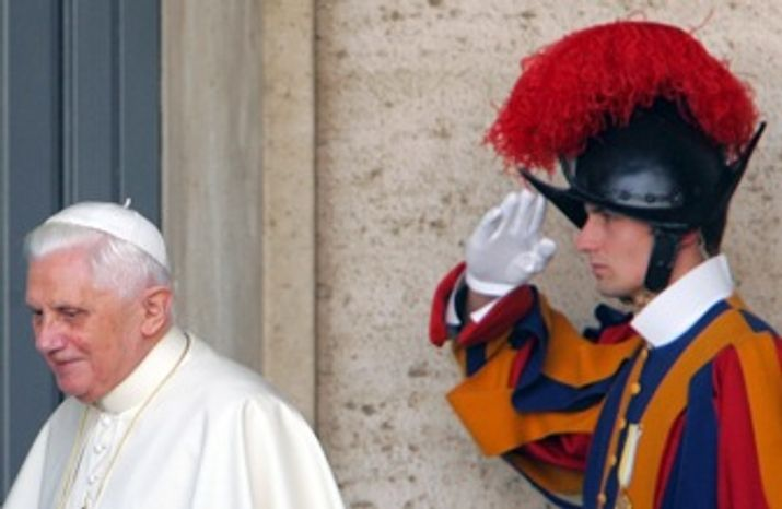 Pope Benedict XVI is saluted by a Swiss guard at the Vatican in November 2007. The head of the Vatican's Swiss Guard has resigned over a dispute that could affect the Pope's security for his U.S. visit.