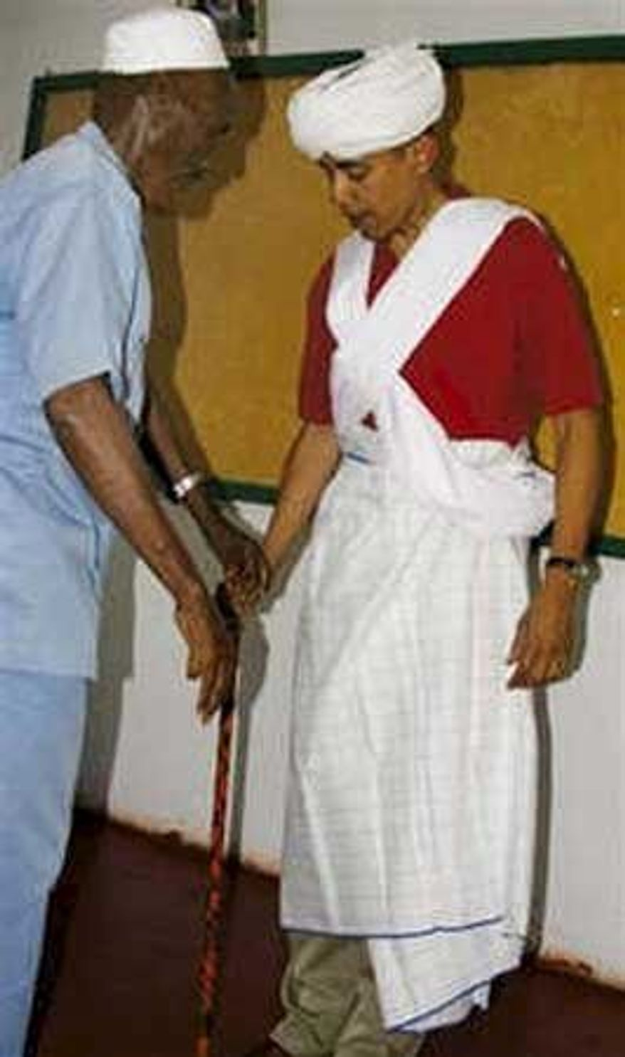 Associated Press Sen. Barack Obama (right) was given local garb by retired chief Sheik Mohamed Hassan during a visit to northeastern Kenya in August 2006.
