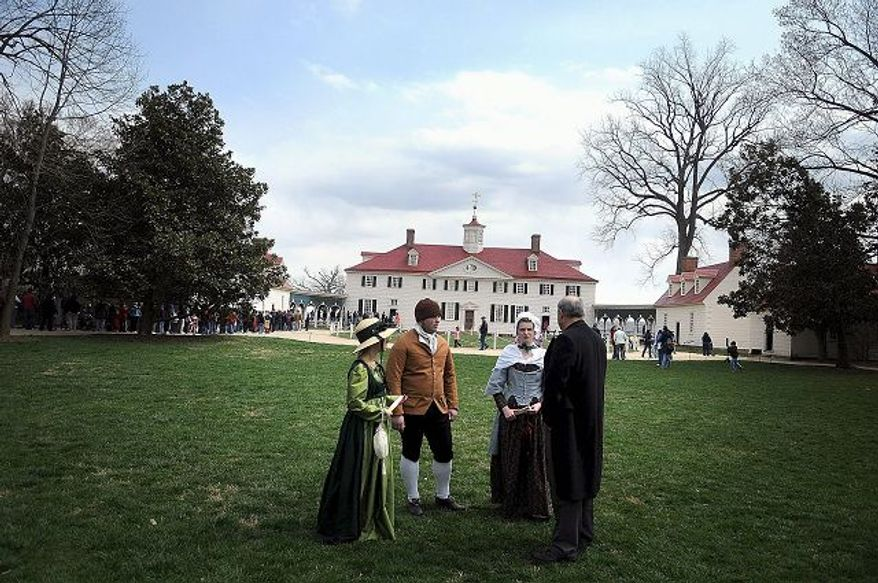 Jim Percoco (far right) visits his students Becky Koenig (second from right), Beth Stinson (left) and Tim Wing (second from left) at Mount Vernon.