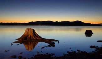 The first light of dawn silhouettes the Katahdin Range east of Chesuncook Lake in Maine. (Associated Press)