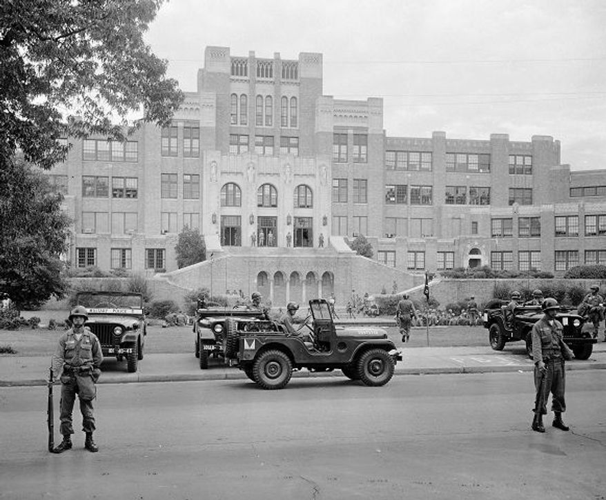 President Eisenhower dispatched paratroopers of the 101st Airborne Division on Sept. 26, 1957, to defend the desegregation of Little Rock's Central High School against the angry crowd, Arkansas National Guard and governor. (AP Photo)