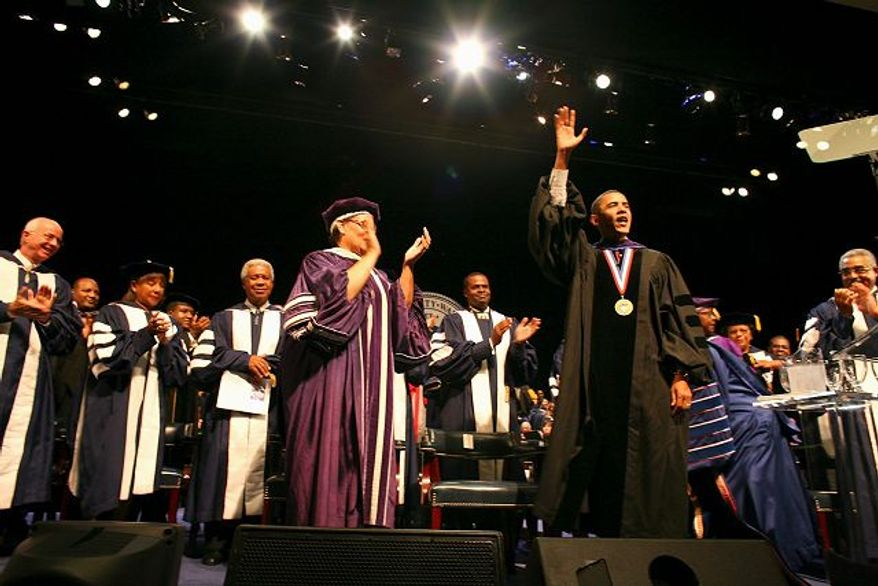 Illinois Sen. Barack Obama waves after delivering Howard University's convocation address. In his speech, the Democratic presidential hopeful said he would end the sentencing disparity between crack and powder cocaine. (Antonio Franco/The Washington Times)