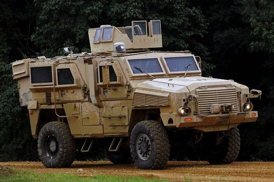 A Category I mine-resistant ambush-protected vehicle was driven on a test course during a media demonstration at Aberdeen Proving Ground, Md., on Aug. 24. In the 1940s, a GI went to war with little more than a uniform, weapon, helmet, bedroll and canteen.