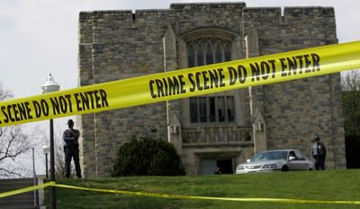 ** FILE ** Police tape surrounds Virginia Tech's Norris Hall on April 18, 2007, two days after Seung-hui Cho killed 30 people there. (AP Photo, File)