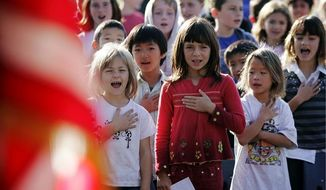 This 2007 file photo shows Palo Alto, Calif., pupils reciting the Pledge of Allegiance. (Associated Press) ** FILE **