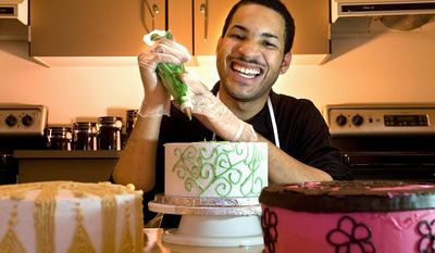 Jerome Addison, a senior at Suitland High School and one of Ms. Lofland's students, won an entrepreneurship contest with a business plan for his cake decorating. Addison also bakes and designs cakes, some of which consist of several multitiered wedding cakes..
