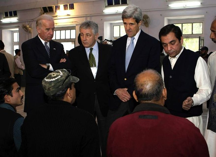 Associated Press Sens. Joseph R. Biden Jr. (left), Delaware Democrat; Chuck Hagel, Nebraska Republican; and John Kerry, Massachusetts Democrat, gathered at a Lahore polling station, were among the foreign observers at yesterday's elections in Pakistan.