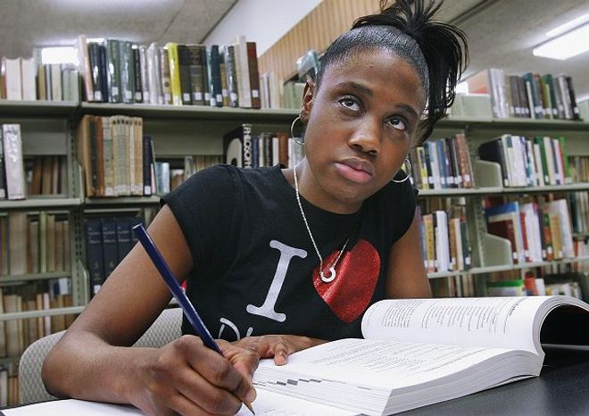 Tinesheia Howard uses the library at Lincoln College in Lincoln, Ill. She spent 18 months in a homeless shelter while attending Chicago's North Lawndale College Preparatory High School. She supports a proposal to create residential programs for homeless students in Chicago. (Associated Press)
