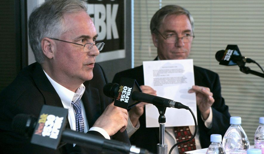 California state Sen. Tom McClintock (left) and former U.S. Rep. Doug Ose debate at radio station KFBK in Sacramento as they run for the GOP nomination for California's 4th Congressional District. Mr. Ose is holding notes that he claims show Mr. McClintock is soft on illegal immigration. (Associated Press) ** FILE **
