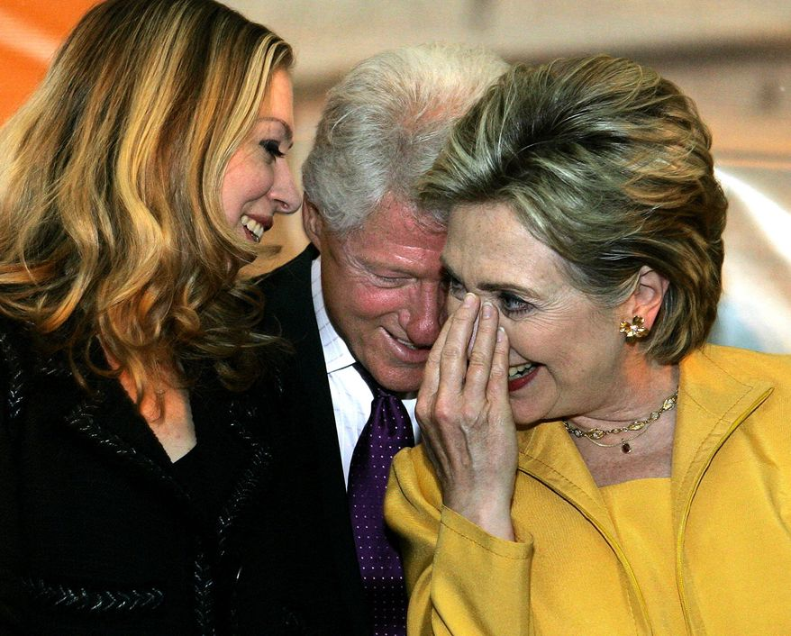 **FILE** Sen. Hillary Rodham Clinton shares a light moment with her husband, former President Bill Clinton, and their daughter, Chelsea, during a rally for her supporters in Ponce, Puerto Rico.