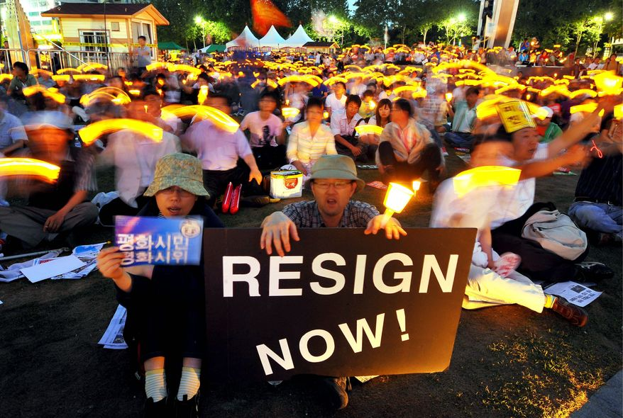 Agence France-Presse/Getty Images Seoul protesters demand the resignation of government officials. Some scholars say the mixed focus of the protests indicate citizens merely seek group experience, and that this urge dangerously usurps their loyalty to the democratic process. Elected by a record margin, the president's approval rating is now less than 20 percent.