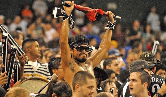 Fan group La Barra Brava has grown to welcome members from 30 countries since Oscar Zambrana founded it in 1995. (Photo by Rodney Lamkey Jr. / The Washington Times) ** FILE **