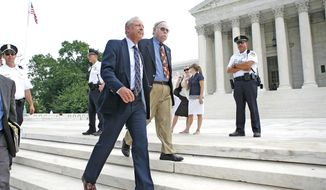 "Plaintiff Rich Heller, who challenged the city's gun ban, leaves the Supreme Court building after the ruling on Thursday. He said  he will register to purchase  a handgun ""very soon."""