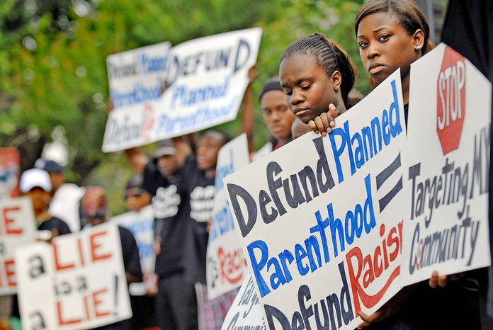 **FILE** Abortion protesters in Washington, D.C., on June 26, 2008, call on politicians to reject donations from Planned Parenthood and other such groups. (The Washington Times)