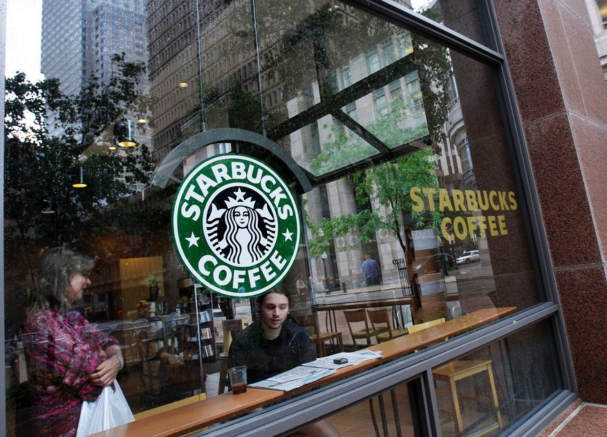 ** FILE ** Patrons sit inside a Starbucks store in downtown Boston in 2008. (Associated Press)