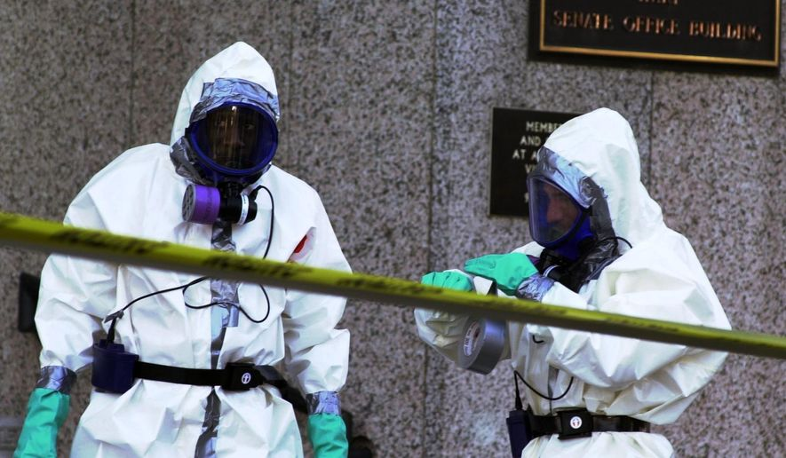 A hazardous materials worker suits up before entering the Hart Senate Office Building at the U.S. Capitol in Washington, DC Thursday, November 1, 2001.