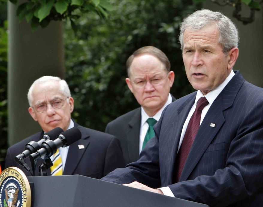 President Bush, accompanied by Attorney General Michael Mukasey, left, and Director of National Intelligence Mike McConnell, center, speaks in the Rose Garden of the White House in Washington, Thursday, July 10,2008, prior to signing the Foreign Intelligence Surveillance Act, (FISA).