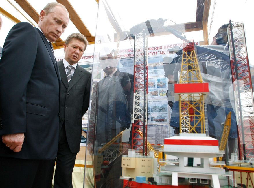 """Getty Images Russian Prime Minister Vladimir Putin (left) and Gazprom chief Alexei Miller visit the Sevmash shipyard in Severodvinsk. Mr. Putin expressed concern about the country's declining oil production and said the sector has reached a """"critical juncture."""""""