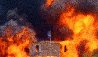Fire engulfs the Branch Davidian compound near Waco, Texas, on April 19, 1993.