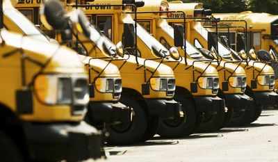 JOHN TULLY/THE WASHINGTON TIMES School districts have to run their buses, and they combing their budgets to find the money to pay for high fuel prices this year. Cuts are likely in other areas to make up the difference.
