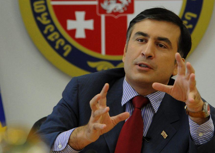 Georgian President Mikheil Saakashvili speaks during a security council meeting in Tbilisi on Saturday, Aug. 9, 2008. (AP Photo/Irakli Gedenidze, Pool)