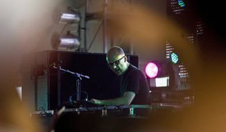 Musician Moby plays a DJ set at the Dance Tent during the Virgin Mobile Festival on August 10, 2008. (John Tully/The Washington Times)