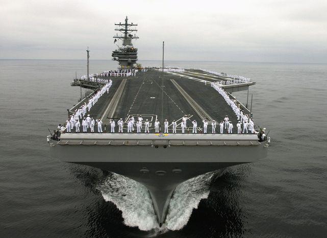 ** FILE ** The aircraft carrier USS Ronald Reagan (Associated Press)