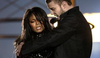 ** FILE ** Justin Timberlake reaches across Janet Jackson just before uncovering her right breast during the halftime performance at Super Bowl XXXVIII in Houston in 2004. (Associated Press)