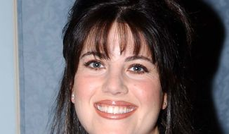 Monica Lewinsky smiles after she appeared at a news conference Wednesday, Jan. 16, 2002 in Pasadena, Calif. to promote an HBO documentary scheduled to debut on March 3, titled 'Monica in Black and White.' The film largely consists of Lewinsky 