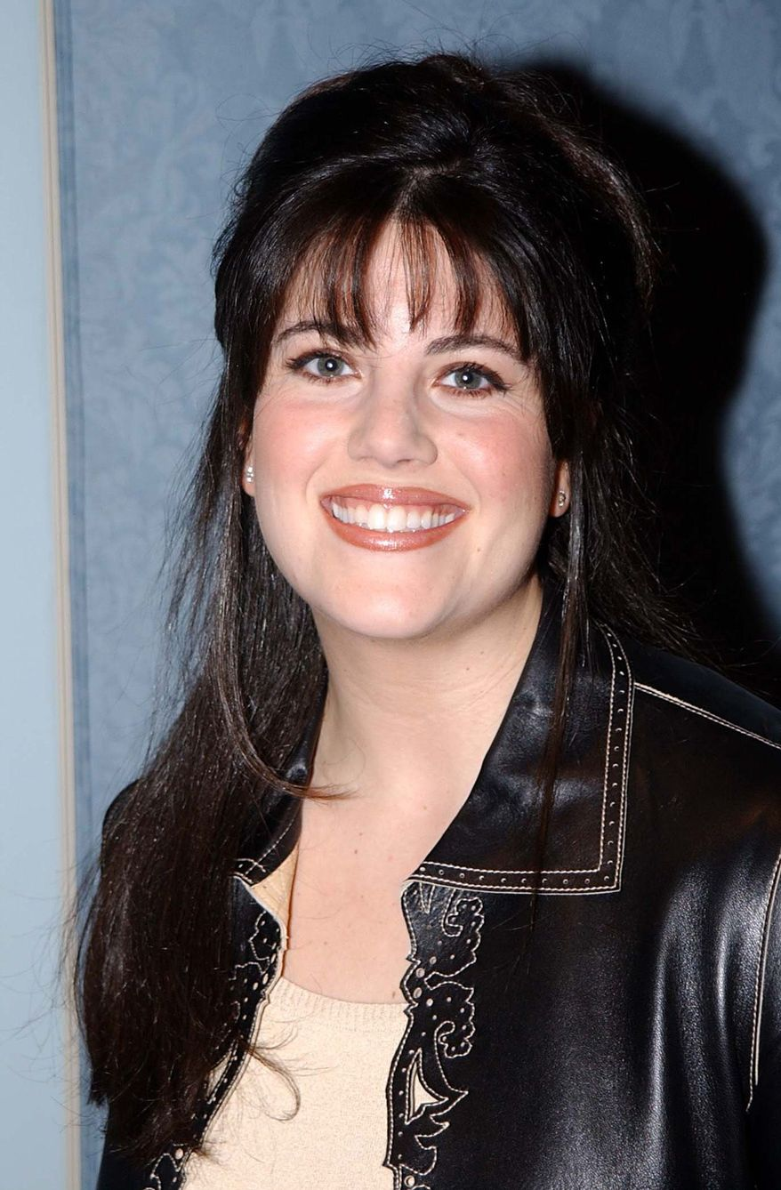 Monica Lewinsky smiles after she appeared at a news conference Wednesday, Jan. 16, 2002 in Pasadena, Calif. to promote an HBO documentary scheduled to debut on March 3, titled 'Monica in Black and White.' The film largely consists of Lewinsky     answering questions from an audience of HBO staff and college students. (AP Photo by Jeff Kravitz/Film Magic)