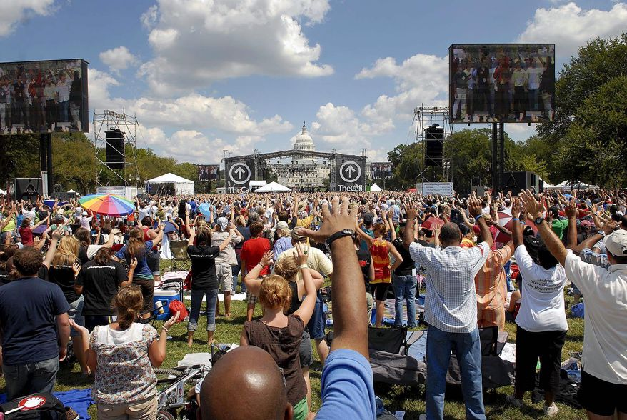 Photographs by Rod Lamkey Jr./The Washington Times A crowd estimated at 50,000 takes part in TheCall DC, a Christian rock concert and day of prayer and fasting, Saturday on the National Mall.