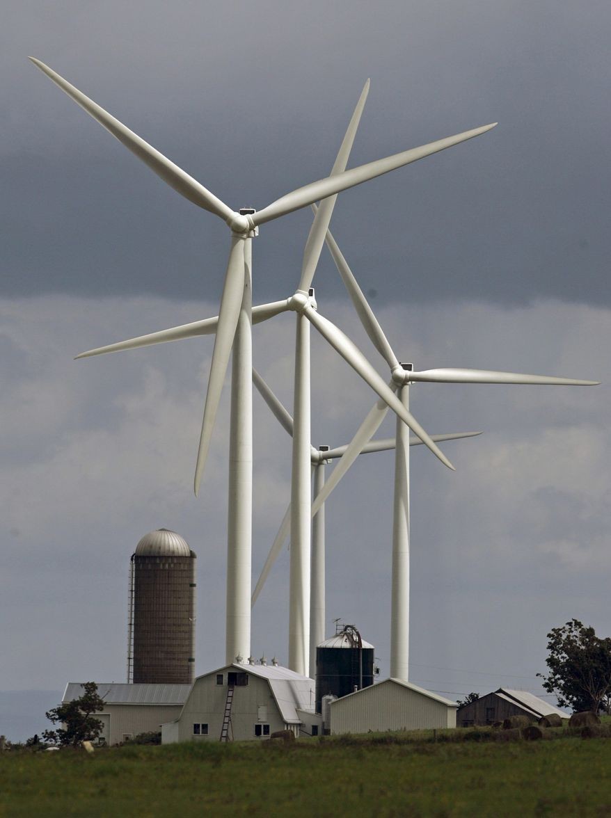 "ASSOCIATED PRESS PHOTOGRAPHS Wind turbines from the Maple Ridge Wind Farm tower over a farm in Lowville, N.Y. John Yancey (left), whose father agreed to have seven windmills erected on family land, dislikes them intensely, despite the guaranteed income they provide. He calls the 400-foot windmills ""monstrosities."""