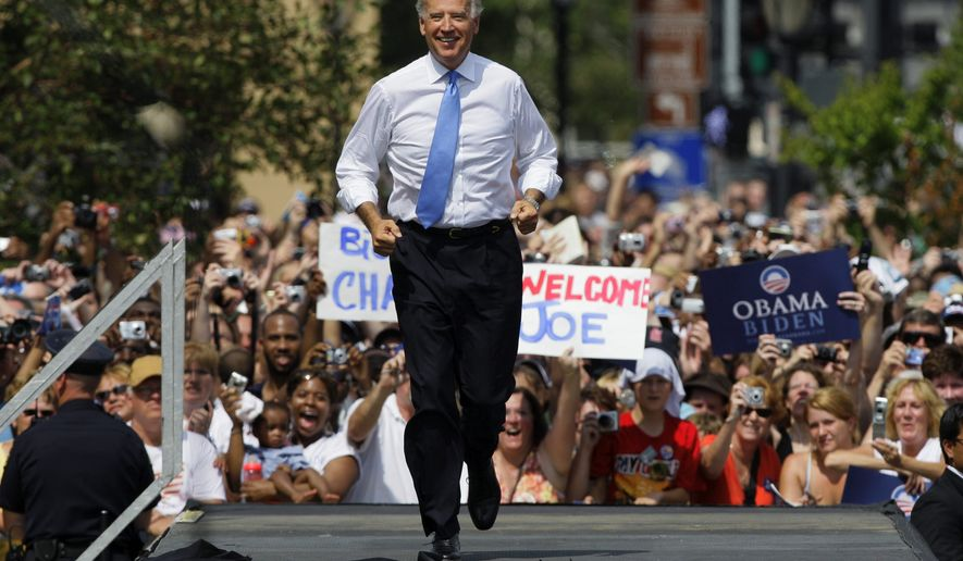 Sen. Joe Biden, D-Del., takes the stage as Democratic presidential candidate Sen. Barack Obama's vice presidential running mate Saturday, Aug. 23, 2008, in Springfield, Ill. (AP Photo/M. Spencer Green)