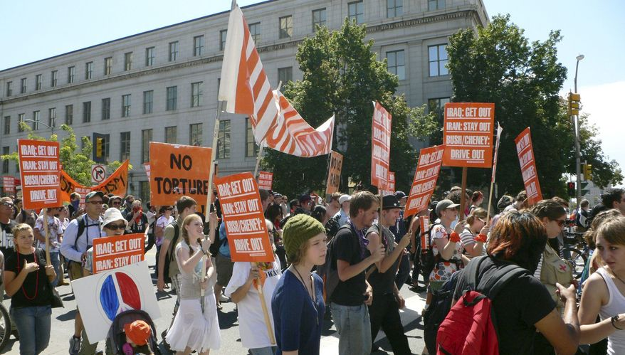 """PHOTOGRAPHS BY CHRISTIAN FUCHS/THE WASHINGTON TIMES Protesters march during a rally sponsored by Recreate 68 in Denver on Sunday. The nonviolent crowd couldn't match the size or enthusiasm of the anti-Vietnam war rallies in the 1960s. """"It's not as big, but it's just as sincere,"""" one participant said."""