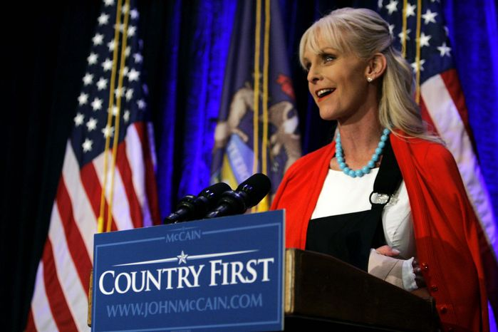 """** FILE ** Cindy McCain, her arm in a sling because of a """"minor sprain"""" suffered when someone shook her hand too vigorously during a campaign event, speaks to reporters on Aug. 13, 2008, in Birmingham, Mich. She is more frequently seen standing quietly by her husband's side, but that can be deceptive. She has a full life out of the limelight as a wife, mother, business chief executive, charity founder and worker for the causes her charities support. (Associated Press)"""