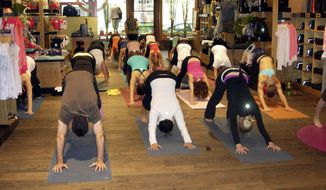 A yoga class gets a strenuous workout at a Lululemon Athletica store in Bethesda, Md.