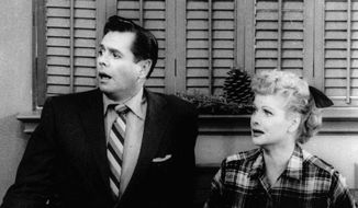 "Desi Arnaz and Lucille Ball, here in CBS' 1956 ""I Love Lucy"" Christmas special, kept audiences laughing, but Jeff Alexander, author of ""A TV Guide to Life,"" says contemporary comedies such as ""The Office"" with Steve Carell (left) are sharper. (Associated Press) ** FILE **"