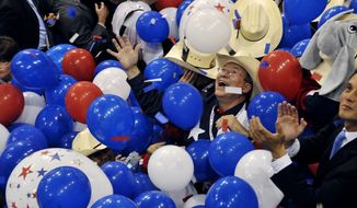 Texas delegates play in a sea of balloons after McCain accepted his party's nomination. (J.M. Eddins Jr. / The Washington Times)