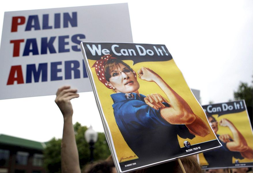 **FILE** Sarah Palin's supporters brandish signs of her depicted as feminist icon Rosie the Riveter while waiting to see Mrs. Palin and Sen. John McCain on Sept. 9, 2008, at a rally at Franklin & Marshall College in Lancaster, Pa. (Associated Press)