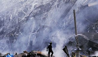 Rescue workers search a mountain of wreckage after the collapse of the Twin Towers. (Steve McCurry/Magnum Photos)