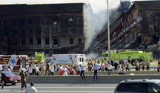 The Pentagon is shown after terrorists crashed an American Airlines Boeing 757 into the building on Sept. 11, 2001. (The Washington Times)