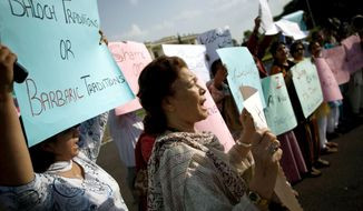 "** FILE ** Pakistani human rights activists demonstrate outside Parliament in Islamabad in 2008. The brutality of recent ""honor killings"" and the police response sparked outrage in Pakistan. (Associated Press)"