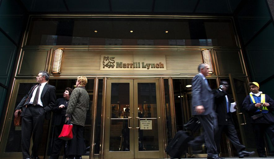 People leave the headquarters of Merrill Lynch & Co. in New York in this November 2007 file photo. (AP Photo/Jin Lee, file)