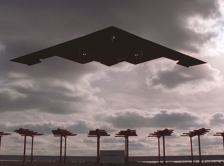 The B-2 Stealth Bomber, made by the Northrop Grumman Corp., is shown landing at Whiteman Air Force Base in Missouri. (Associated Press)