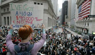 Dara Blumenthal of Brooklyn shows off her personal debt during a rally Thursday on Wall Street against the proposed government bailout. (Associated Press)