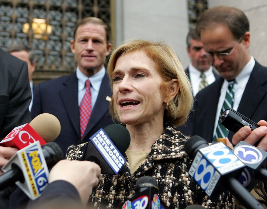 ** FILE ** Assistant U.S. Attorney Nora Dannehy speaks to reporters outside U.S. District Court in New Haven, Conn., in 2005. (AP Photo)